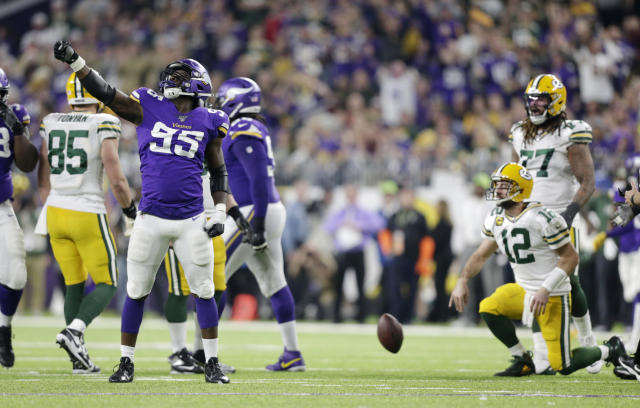 Minnesota Vikings defensive end Ifeadi Odenigbo (95) celebrates after sacking Green Bay Packers quarterback Aaron Rodgers (12) during the second half of an NFL football game Monday, Dec. 23, 2019, in Minneapolis. (AP Photo/Andy Clayton-King)