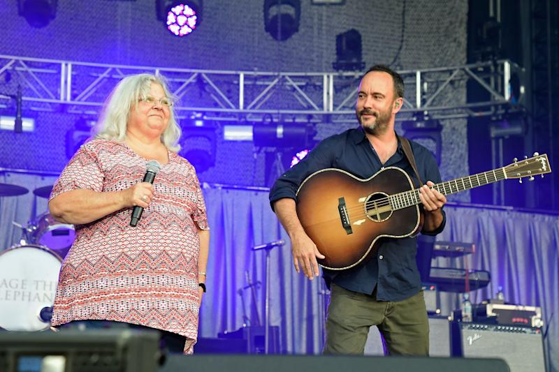 Susan Bro, mother of Heather Heyer, and Dave Matthews speak onstage at A Concert for Charlottesville.