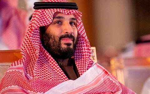 Crown Prince Mohammed bin Salman has led the reforms to modernise Saudi but has also faced criticism for the mass arrest of women's rights activists - Credit: AFP