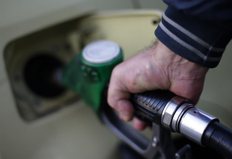 A man fills up his car at a petrol station in Rome