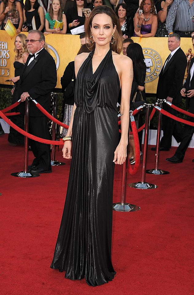 "<p class=""MsoNormal""><b>Best Dressed at the Screen Actors Guild Awards</b><br> Before she got people talking at the Oscars, Angelina Jolie stopped the show at the SAG Awards with her simple, yet elegant Jenny Packham gown that draped at the neckline – and covered both her legs nicely. The actress finished off the look with a House of Lavande bracelet and earrings, Platt Boutique rings, and Gucci heels.</p>"