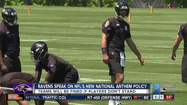 Baltimore Ravens' Coach John Harbaugh issued a statement during the team's Organized Team Activity, Thursday, about the NFL's new policy threatening fines for players who kneel on the field during the pregame playing of the national anthem.