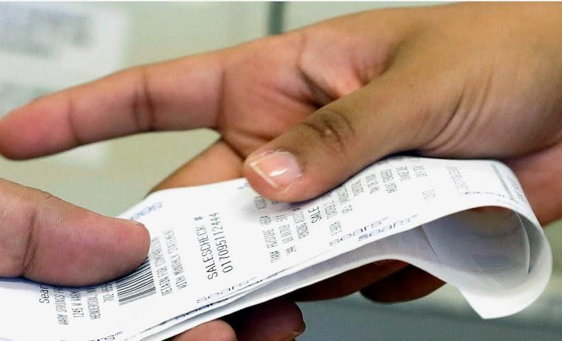Retail giants face pressure to change chemical-coated receipt paper