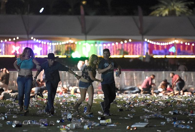 Las Vegas concert-goers flee on October 1, 2017 after a gunman opened fire from a nearby hotel, killing 58 (AFP Photo/David Becker)