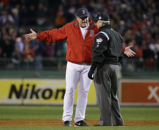 Boston Red Sox manager John Farrell argues a call with umpire Dana DeMuth during the second inning of Game 1 of baseball's World Series against the St. Louis Cardinals Wednesday, Oct. 23, 2013, in Boston. (AP Photo/Matt Slocum)