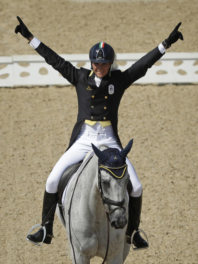 <p>Pietro Roman, of Italy, celebrates on Barraduff after competing in the equestrian eventing dressage competition at the 2016 Summer Olympics in Rio de Janeiro, Brazil, Sunday, Aug. 7, 2016. (AP Photo/John Locher) </p>