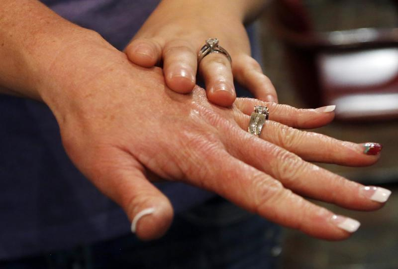 Shauna Griffen and Brooke Shepherd show their rings after getting married in Salt Lake City
