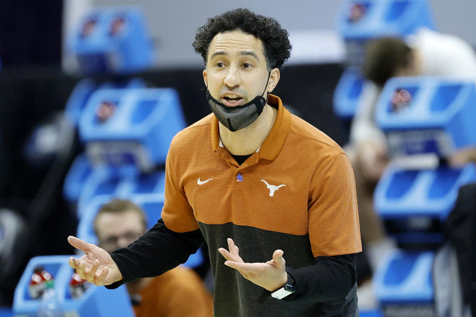 Texas coach Shaka Smart talks to his players during a loss to  Abilene Christian in the first round of the NCAA tournament on March 20. (Tim Nwachukwu/Getty Images)