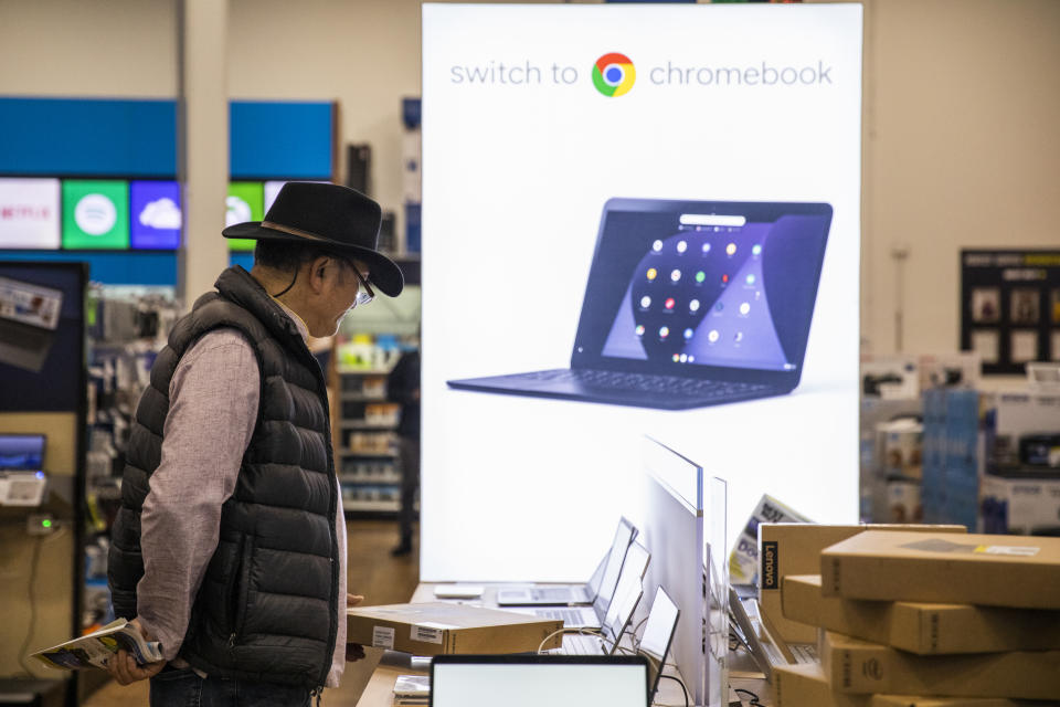 EMERYVILLE, CA - NOVEMBER 29: A Black Friday shopper looks at laptop computers at a Best Buy store on November 29, 2019 in Emeryville, United States. Black Friday is traditionally the biggest shopping event of the year, and marks the beginning of the holiday shopping season. (Photo by Philip Pacheco/Getty Images)