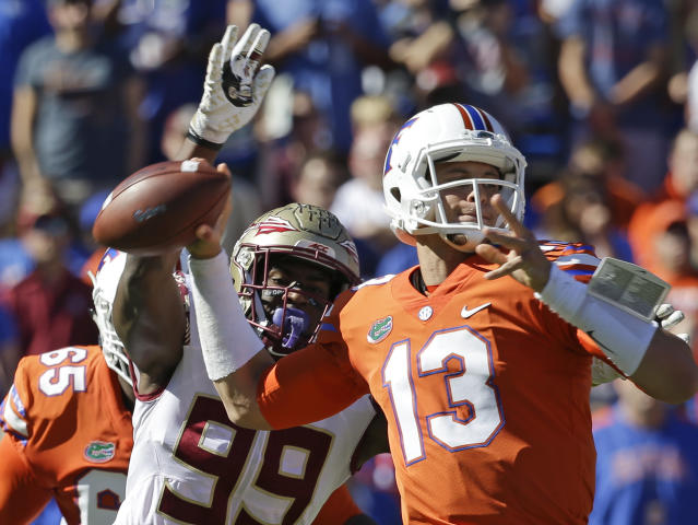 FILE - In this Nov. 25, 2017, file photo, Florida State defensive end Brian Burns (99) strips the ball from the hand of Florida quarterback Feleipe Franks (13) during the first half of an NCAA college football game, in Gainesville, Fla. Burns is a possible pick in the 2019 NFL Draft. (AP Photo/John Raoux, File)