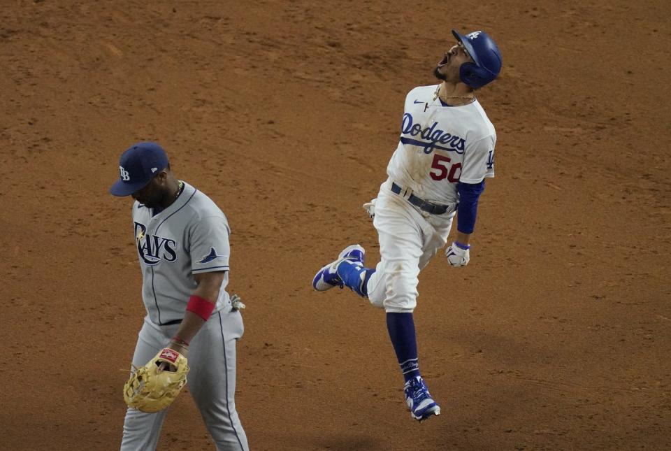 """<span class=""""caption"""">The 2020 World Series featured two teams at opposite ends of the salary spectrum: the Los Angeles Dodgers and Tampa Bay Rays. The richer Dodgers were the winners.</span> <span class=""""attribution""""><span class=""""source"""">(AP Photo/Sue Ogrocki)</span></span>"""