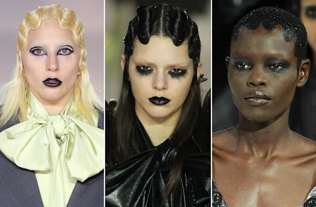 <p>FW16 Models including Lady Gaga and Kendall Jenner wore wet finger waves with straight ends, and a third model had painted-in glittery hair. Each had bleached brows and unique eye makeup. (Photo: Getty Images) </p>