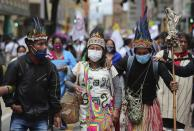 A group of Indigenous march during a national strike in Bogota, Colombia, Wednesday, Oct. 21, 2020. Workers' unions, university students, human rights defenders, and Indigenous communities have gathered for a day of protest in conjunction with a national strike across Colombia. The protest is against the assassinations of social leaders, in defense of the right to protest and to demand advances in health, income and employment. (AP Photo/Fernando Vergara)