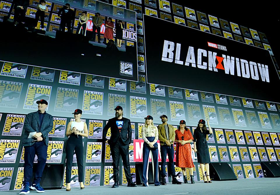 SAN DIEGO, CALIFORNIA - JULY 20: (L-R) President of Marvel Studios Kevin Feige, Scarlett Johansson, David Harbour, Florence Pugh, O-T Fagbenle, Director Cate Shortland and Rachel Weisz of Marvel Studios' 'Black Widow' at the San Diego Comic-Con International 2019 Marvel Studios Panel in Hall H on July 20, 2019 in San Diego, California. (Photo by Alberto E. Rodriguez/Getty Images for Disney)