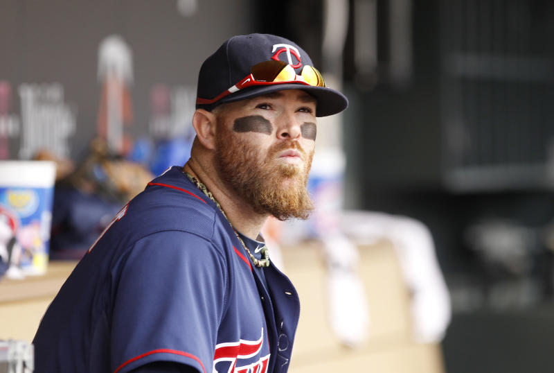 Minnesota Twins' Ryan Doumit sits in the dugout prior to a baseball game against the Tampa Bay Rays in Minneapolis, Sunday, Sept. 15, 2013. The Twins beat the Rays 6-4. (AP Photo/Ann Heisenfelt)