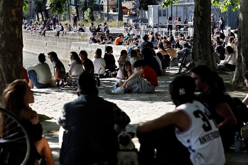 Parisians seem intent on enjoying the sunshine. Source: Getty