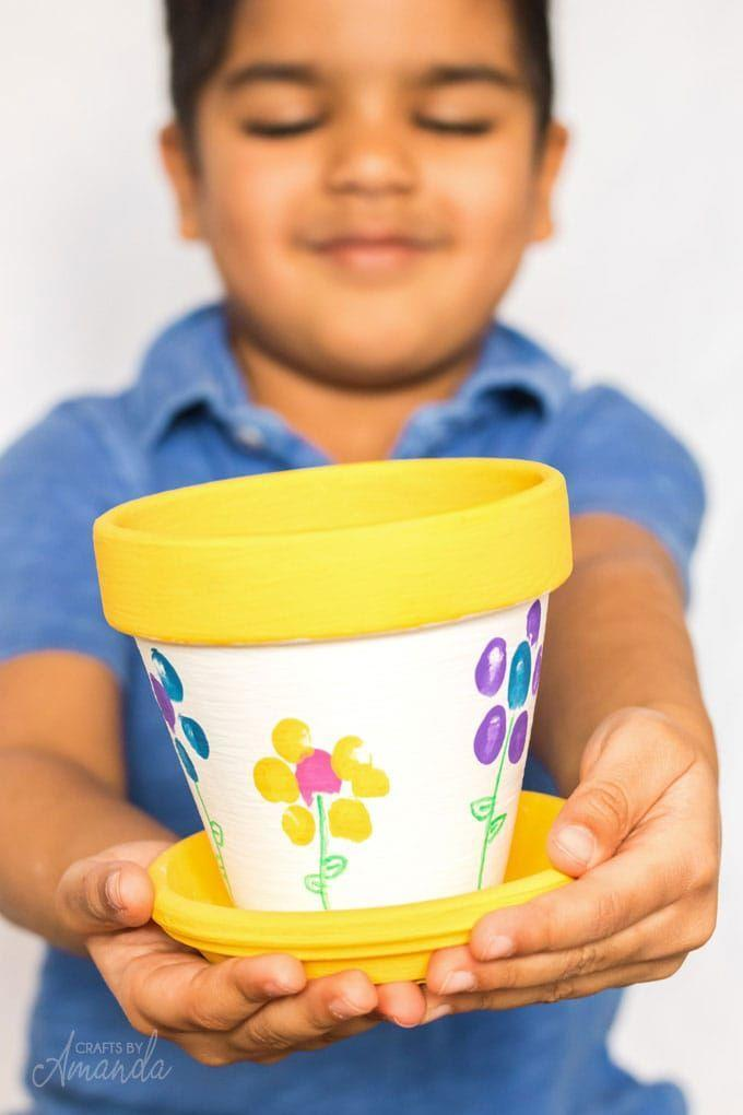 """<p>With some inexpensive terra cotta pots and acrylic paint, party guests can decorate their own fingerprint pots, which they can use to plot their own plant later on. </p><p><strong><em><a href=""""https://craftsbyamanda.com/fingerprint-flower-pot/"""" rel=""""nofollow noopener"""" target=""""_blank"""" data-ylk=""""slk:Get the tutorial at Crafts by Amanda"""" class=""""link rapid-noclick-resp"""">Get the tutorial at Crafts by Amanda</a>. </em></strong></p><p><a class=""""link rapid-noclick-resp"""" href=""""https://www.amazon.com/Inch-Terra-Cotta-Pots-Saucer/dp/B07T4TF63M?tag=syn-yahoo-20&ascsubtag=%5Bartid%7C10070.g.37055924%5Bsrc%7Cyahoo-us"""" rel=""""nofollow noopener"""" target=""""_blank"""" data-ylk=""""slk:SHOP POTS"""">SHOP POTS</a></p>"""