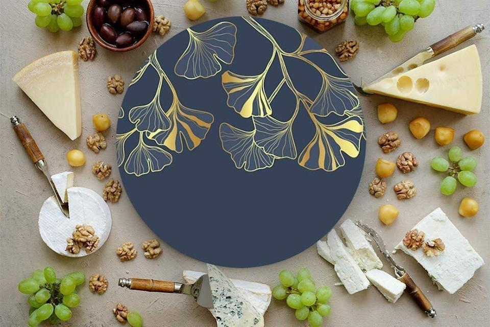 <p>Charcuterie nights will never be the same with the stunning <span>RAIZ DE MEXICO Handmade Cheese Board</span> ($29).</p>