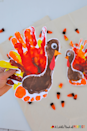 """<p>Not only a perfect Thanksgiving project—and a cute harvest decoration—this craft will forever remind you of the time when your littles really were little.</p><p><strong>Get the tutorial at <a href=""""https://alittlepinchofperfect.com/handprint-and-footprint-turkey-an-adorable-thanksgiving-craft-for-kids/"""" rel=""""nofollow noopener"""" target=""""_blank"""" data-ylk=""""slk:A Little Pinch of Perfect"""" class=""""link rapid-noclick-resp"""">A Little Pinch of Perfect</a>.</strong></p><p><a class=""""link rapid-noclick-resp"""" href=""""https://www.amazon.com/Crafts-ALL-Pigments-Beginners-Professional/dp/B01EVJ8Q0Q?ref_=fsclp_pl_dp_3&tag=syn-yahoo-20&ascsubtag=%5Bartid%7C10050.g.1201%5Bsrc%7Cyahoo-us"""" rel=""""nofollow noopener"""" target=""""_blank"""" data-ylk=""""slk:SHOP CRAFT PAINT"""">SHOP CRAFT PAINT</a><br></p>"""