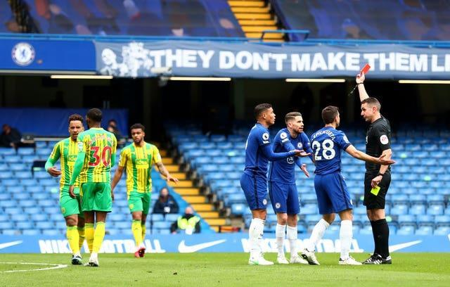Chelsea defender Thiago Silva is shown a red card