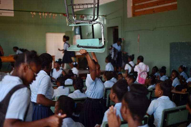 Over-crowding is rampant in Haiti's underfunded schools, with classes of up to 80 students in the upper grades (AFP Photo/HECTOR RETAMAL)