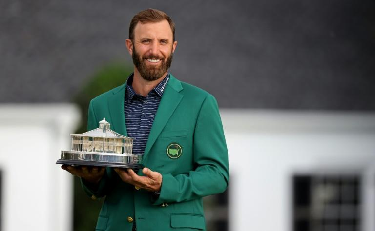 Dustin Johnson holds the Masters Trophy after his record-breaking 20-under par victory total at Augusta