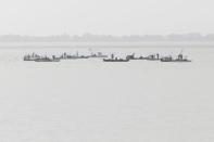 Oysters Boats are clustered together as they harvest oysters in Apalachicola Bay