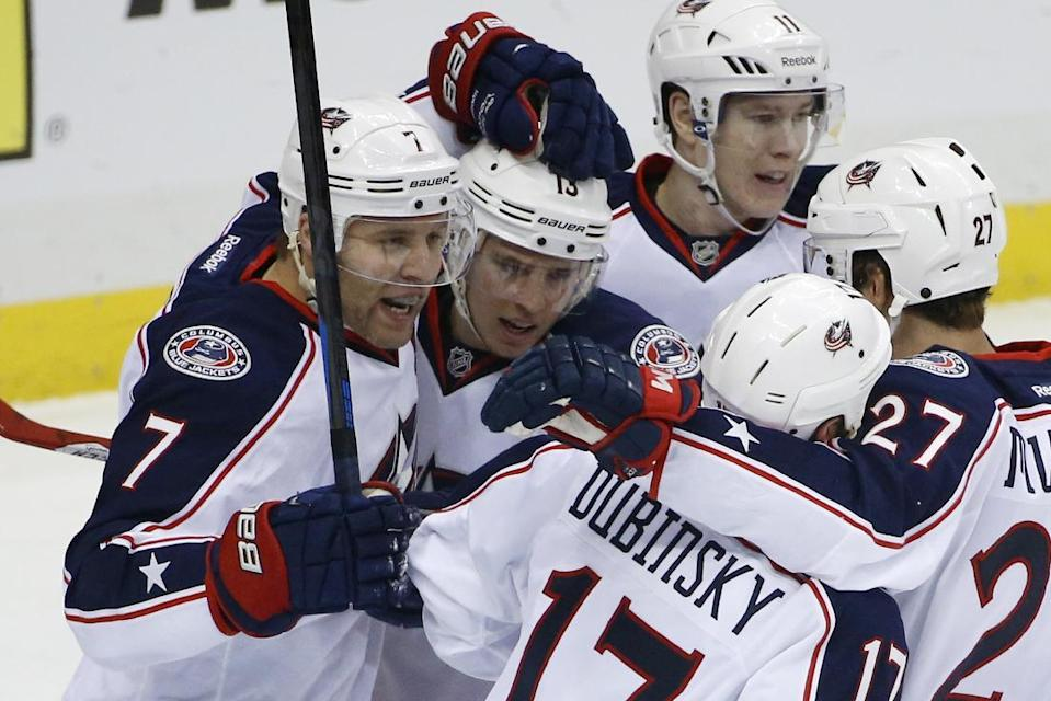 Columbus Blue Jackets' Jack Johnson (7) celebrates his goal with teammates in the first period of a first-round NHL playoff hockey game against the Pittsburgh Penguins in Pittsburgh on Wednesday, April 16, 2014.(AP Photo/Gene J. Puskar)