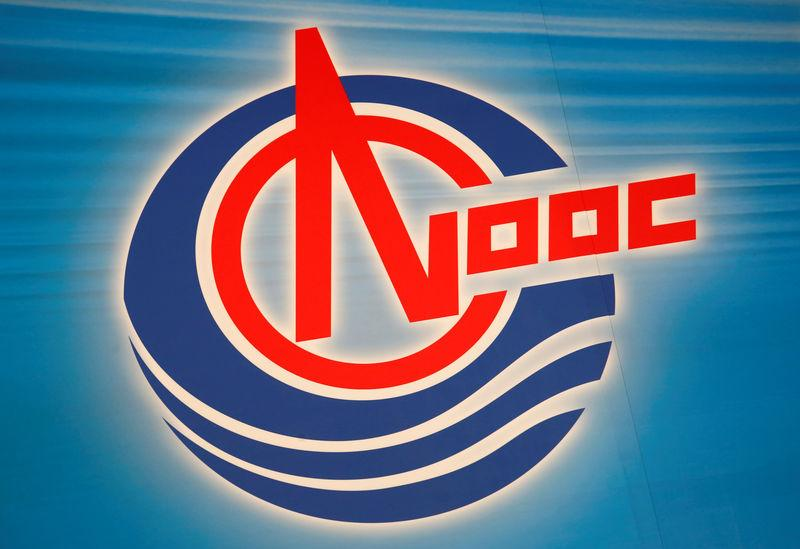 FILE PHOTO: The company logo of CNOOC Ltd is displayed at a news conference on the company's annual results in Hong Kong