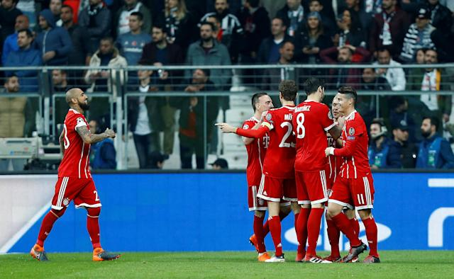 Soccer Football - Champions League Round of 16 Second Leg - Besiktas vs Bayern Munich - Vodafone Arena, Istanbul, Turkey - March 14, 2018 Bayern Munich players celebrate after Besiktas' Gokhan Gonul (not pictured) scores an own goal and the second goal for Bayern Munich REUTERS/Osman Orsal
