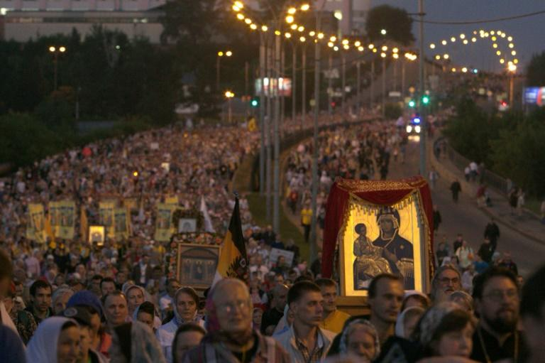 Many of the fervent believers came from across Russia and abroad to take part in the colourful ceremony during which many carried icons