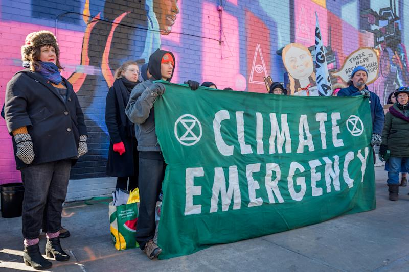 BROOKLYN, NY, UNITED STATES - 2020/02/29: Protesters holding a Climate Emergency banner. Community members from across North Brooklyn joined climate activist group Extinction Rebellion NYC at a rally on Manhattan Avenue and Moore Street near the construction site of National Grids controversial Metropolitan Reliability Infrastructure (MRI) project shutting down again construction for the day. Community calls for immediate, permanent halt of construction and on Mayor De Blasio, and Governor Cuomo to oppose project. (Photo by Erik McGregor/LightRocket via Getty Images)