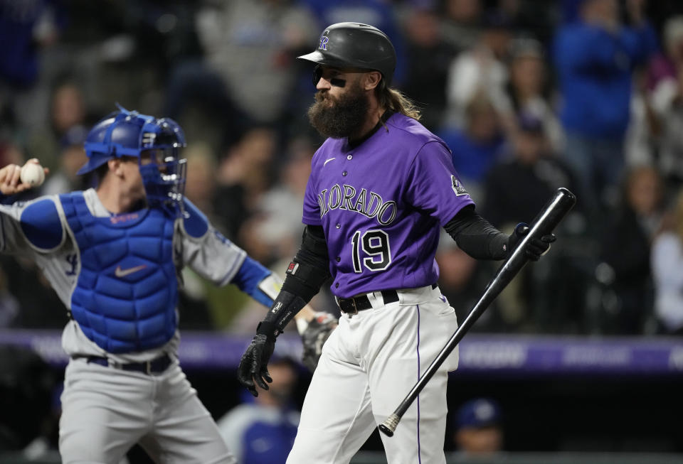 Colorado Rockies' Charlie Blackmon reacts after striking out with the bases loaded against Los Angeles Dodgers relief pitcher Blake Treinen to end the seventh inning of a baseball game Tuesday, Sept. 21, 2021, in Denver. (AP Photo/David Zalubowski)
