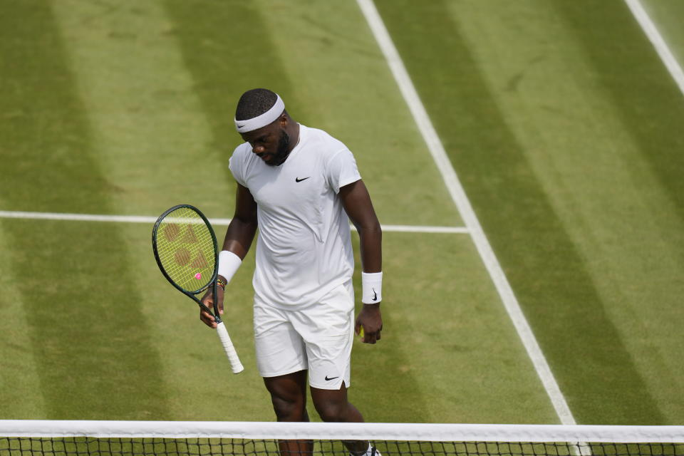 Frances Tiafoe of the US reacts after losing a point to Russia's Karen Khachanov during the men's singles third round match on day five of the Wimbledon Tennis Championships in London, Friday July 2, 2021. (AP Photo/Alastair Grant, Pool)