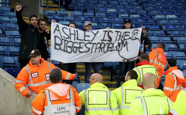 "Newcastle fans hold a banner saying ""Ashley is the biggest problem"" during their Premier League match against Leicester in September (Nick Potts/PA)"