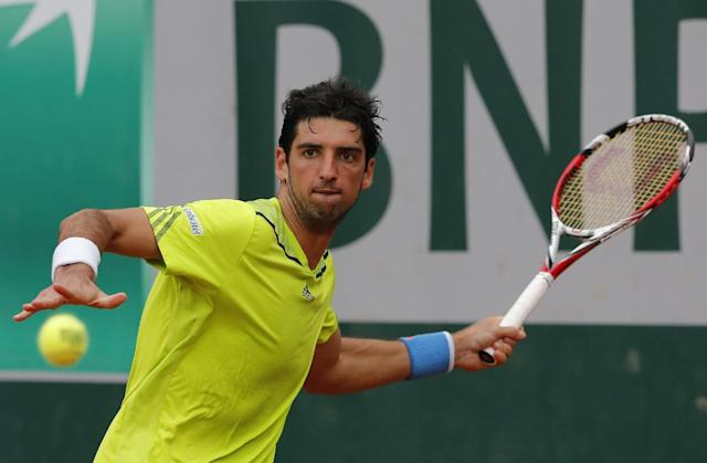 Brazil's Thomaz Bellucci returns the ball to Italy's Fabio Fognini during the second round match of the French Open tennis tournament at the Roland Garros stadium, in Paris, France, Thursday, May 29, 2014. (AP Photo/Michel Spingler)