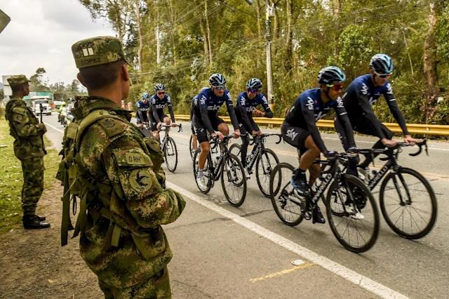 Watching closely: Two soldiers stand guard as Chris Froome trains (AFP Photo/JOAQUIN SARMIENTO)