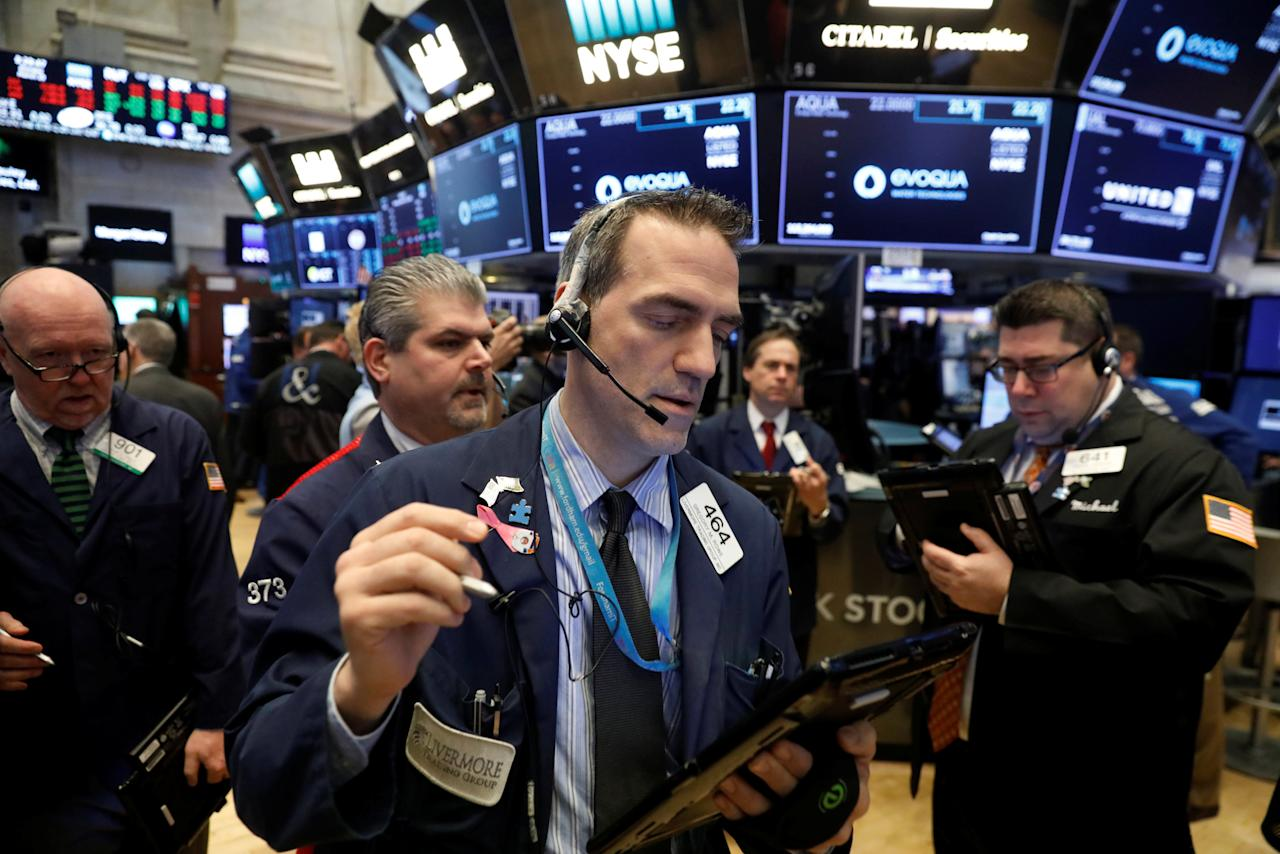 Traders work on the floor of the New York Stock Exchange shortly after the opening bell in New York, U.S., March 19, 2018.  REUTERS/Lucas Jackson