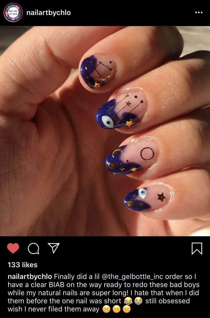 """<p>If you're a zodiac lover or take guidance from all things celestial, try out this abstract blue-toned mani with gold stars and moon accents <a href=""""https://www.instagram.com/nailartbychlo/"""" rel=""""nofollow noopener"""" target=""""_blank"""" data-ylk=""""slk:by nail technician Chlo"""" class=""""link rapid-noclick-resp"""">by nail technician Chlo</a>. It's just mysterious enough for Halloween, but can also be worn after the holiday is over.<br></p><p><a class=""""link rapid-noclick-resp"""" href=""""https://go.redirectingat.com?id=74968X1596630&url=https%3A%2F%2Fwww.etsy.com%2Flisting%2F824084584%2Fmoon-and-stars-nail-decalsstickers&sref=https%3A%2F%2Fwww.oprahdaily.com%2Fbeauty%2Fskin-makeup%2Fg33239588%2Fhalloween-nail-ideas%2F"""" rel=""""nofollow noopener"""" target=""""_blank"""" data-ylk=""""slk:SHOP GOLD DECALS"""">SHOP GOLD DECALS</a></p>"""