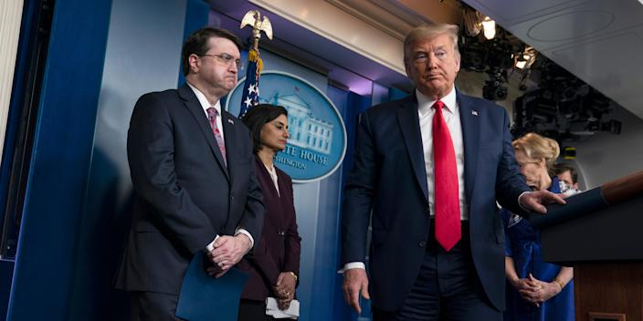 President Donald Trump departs after a press briefing with the coronavirus task force, at the White House, Wednesday, March 18, 2020, in Washington, with Veterans Affairs Secretary Robert Wilkie, Administrator of the Centers for Medicare and Medicaid Services Seema Verma and Dr. Deborah Birx, White House coronavirus response coordinator. (AP Photo/Evan Vucci)