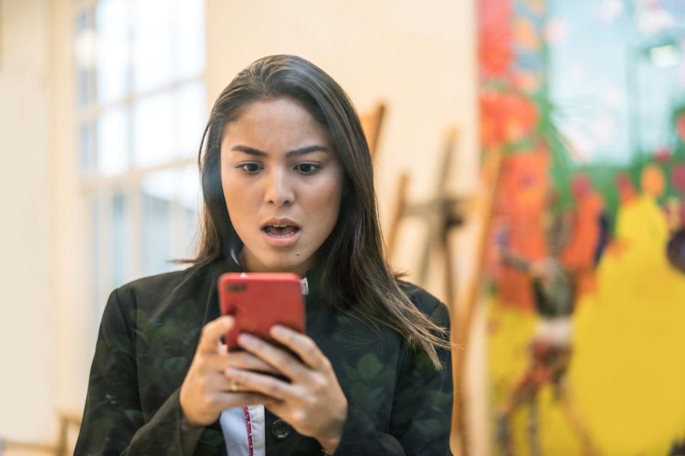 Woman looking at phone upset
