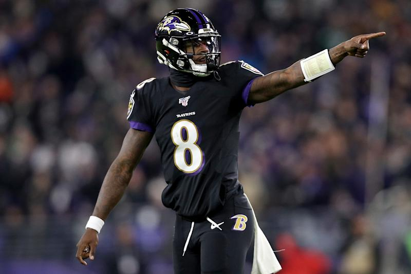 Baltimore Ravens QB Lamar Jackson broke Michael Vick's NFL record for QB rush yards in a season. (Photo by Patrick Smith/Getty Images)