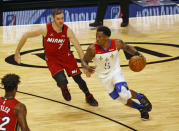 New Orleans Pelicans guard Eric Bledsoe (5) dribbles against Miami Heat guard Goran Dragic (7) during the first half of an NBA basketball game, Friday, Dec. 25, 2020, in Miami. (AP Photo/Joel Auerbach)