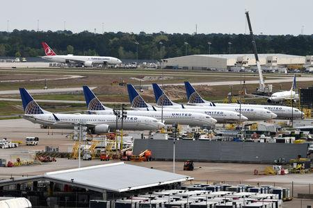 United Airlines planes, including a Boeing 737 MAX 9 model, are pictured at George Bush Intercontinental Airport in Houston, Texas, U.S., March 18, 2019.  REUTERS/Loren Elliott/File Photo