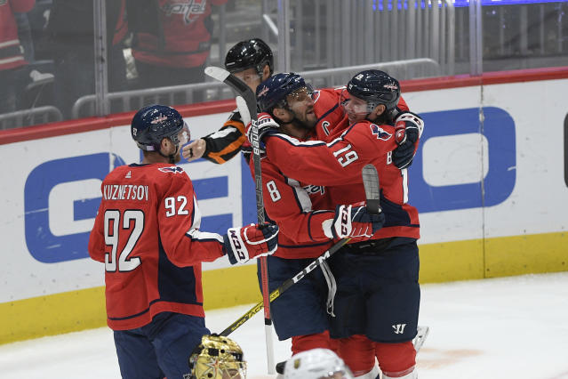 Washington Capitals center Nicklas Backstrom (19), of Sweden, celebrates his goal with left wing Alex Ovechkin (8), of Russia, and center Evgeny Kuznetsov (92), of Russia, during the third period of the team's NHL hockey game against the Vegas Golden Knights, Saturday, Nov. 9, 2019, in Washington. The Capitals won 5-2. (AP Photo/Nick Wass)