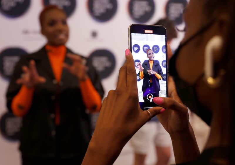 """Singer-songwriter Arlo Parks is seen on a smartphone during an interview following her nomination in the Hyundai Mercury Prize """"Albums of the Year"""" ceremony in London"""