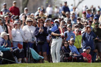 Rory McIlroy, center, of Northern Ireland, hits from the gallery to the sixth green during the second round of the Arnold Palmer Invitational golf tournament Friday, March 6, 2020, in Orlando, Fla. (AP Photo/John Raoux)