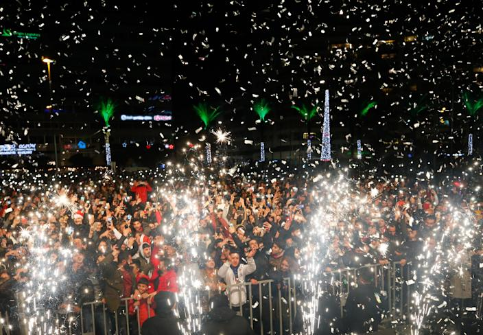 People attend the New Year's Eve celebrations at Cumhuriyet Square. (Photo: Evren Atalay/Anadolu Agency/Getty Images)