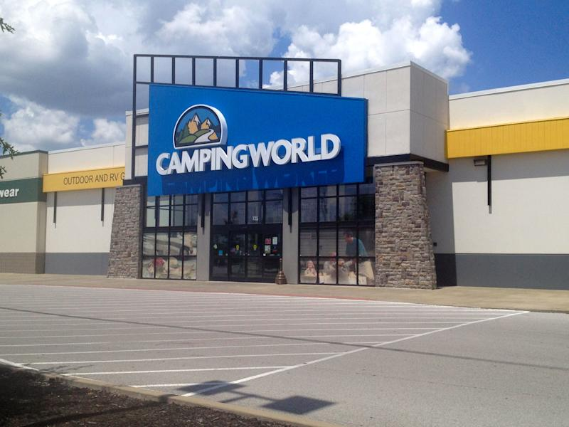 Camping World storefront with an empty parking lot and a partly cloudy sky.
