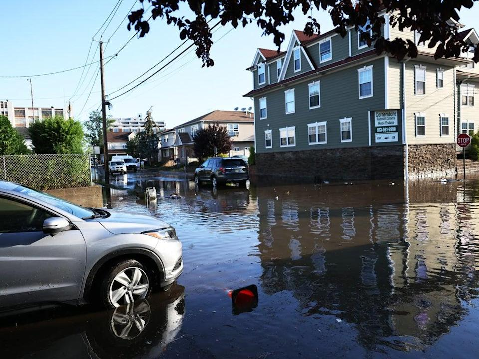 A stranded car in flood water is seen on Lester Street on September 02, 2021 in Passaic City (Getty Images)